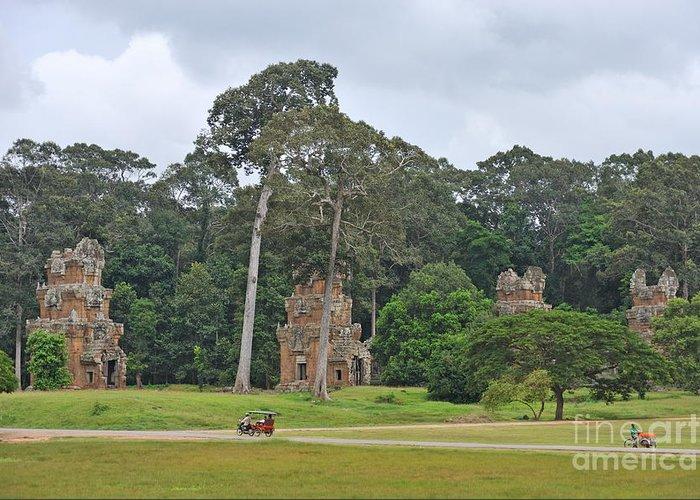 Angkor Greeting Card featuring the photograph Ruins And Tourists At Angkor Wat by Sami Sarkis