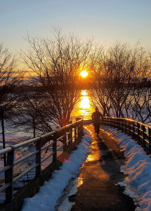 Blue Boston Bridge Ice Jog Jogging Life Magnificent Melting Nature Never Passion River Running Shadow Shinning Sky Snow Splendid Sport Sports Stop Sun Sunset Wet Winter Greeting Card featuring the photograph Running In Sunset by Paul Ge
