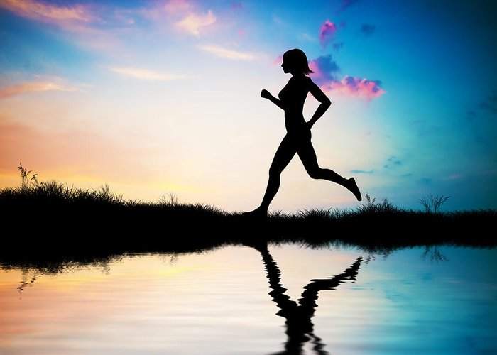 Fit Greeting Card featuring the photograph Silhouette Of Woman Running At Sunset by Michal Bednarek