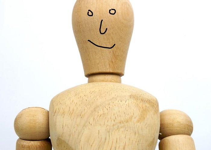 Back Greeting Card featuring the photograph Smiling Wooden Figurine by Bernard Jaubert