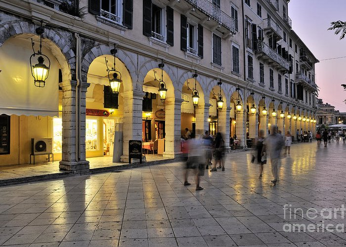 Corfu; Kerkyra; Old; City; People; Tourists; Walk; Walking; Dusk; Twilight; Lights; Spianada; Square; Ionion; Ionian; Greece; Hellas; Greek; Hellenic; Island; Europe; Prints Greeting Card featuring the photograph Spianada Square During Dusk Time by George Atsametakis