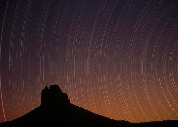 Blurred Motion Greeting Card featuring the photograph Startrails Over Shiprock In The Four by Tim Fitzharris