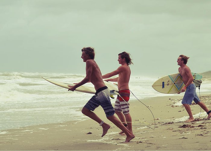 Surfer Greeting Card featuring the photograph Storm Surfers by Laura Fasulo