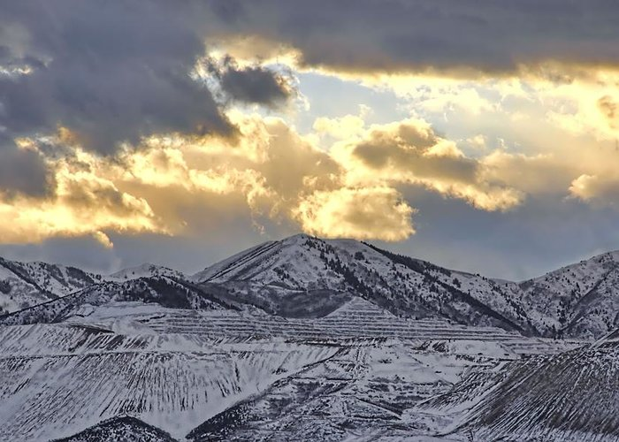 Storm Clouds Greeting Card featuring the photograph Stormy Sunset Over Snow Capped Mountains by Tracie Kaska