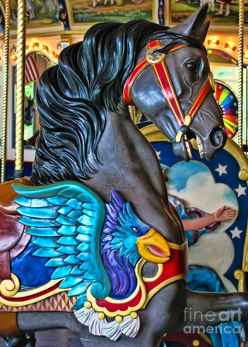 Carousels Carousel Greeting Card featuring the photograph The Eagle And Horse by Colleen Kammerer