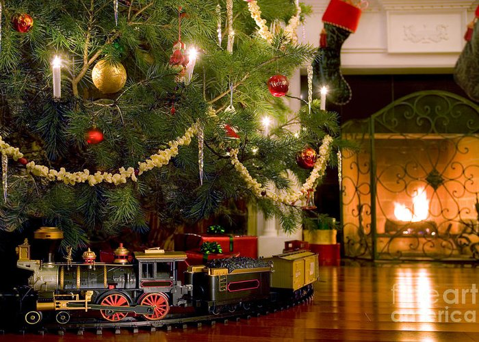 Christmas Greeting Card featuring the photograph Toy Train Under The Christmas Tree by Diane Diederich