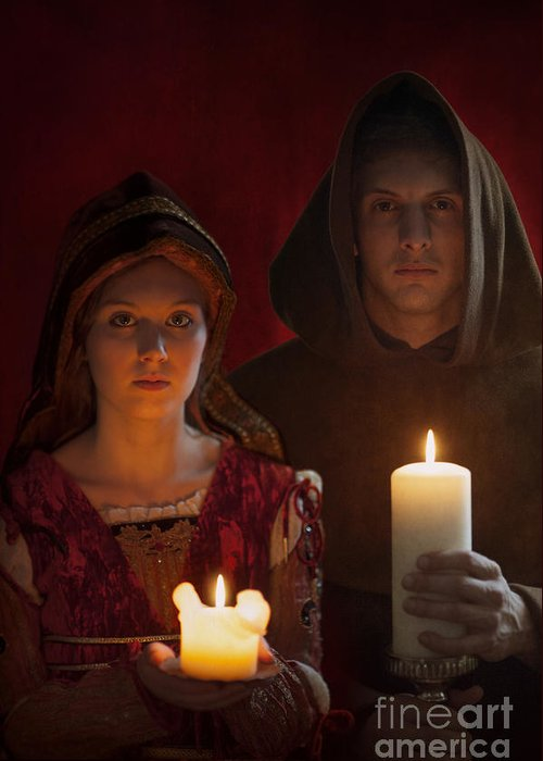 Medieval Greeting Card featuring the photograph Tudor Medieval Young Attractive Couple Holding Candles by Lee Avison