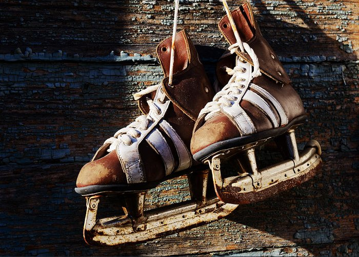 Sport Greeting Card featuring the photograph Vintage Pair Of Mens Ice Skates Hanging On A Wooden Wall With C by Mikhail Olykaynen