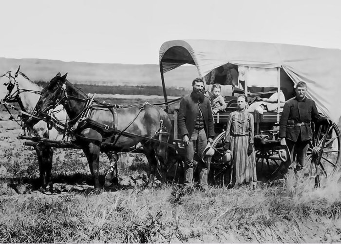 Nebraska Greeting Card featuring the photograph Westward Family In Covered Wagon C. 1886 by Daniel Hagerman