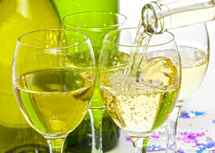 White Greeting Card featuring the photograph White Wine Pouring Into Glasses by Colin and Linda McKie