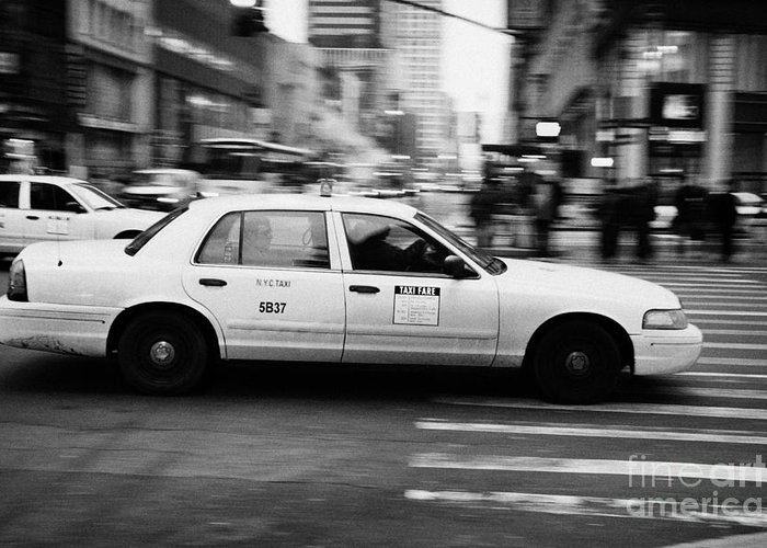 Usa Greeting Card featuring the photograph Yellow Cab Blurring Past Crosswalk And Pedestrians New York City Usa by Joe Fox