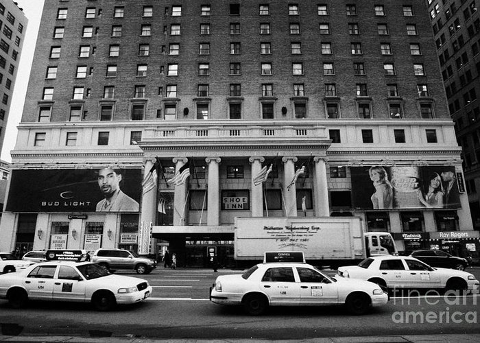 Usa Greeting Card featuring the photograph Yellow Cabs Go Past Pennsylvania Hotel On 7th Avenue New York City Usa by Joe Fox