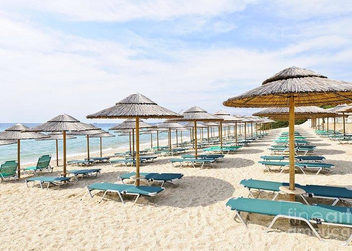 Beach Greeting Card featuring the photograph Beach Umbrellas On Sandy Seashore by Elena Elisseeva