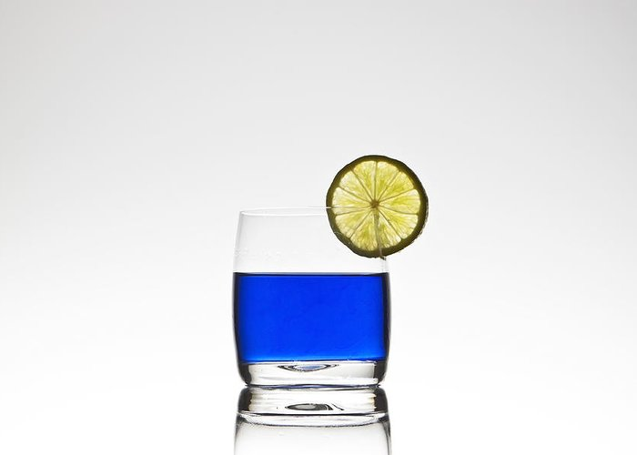 Glass Greeting Card featuring the photograph Blue Cocktail With Lemon by Joana Kruse