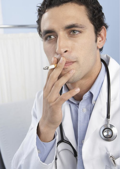 Human Greeting Card featuring the photograph Doctor Smoking by Adam Gault