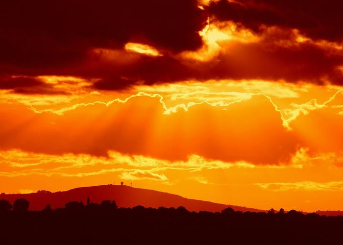 Gifts From The Camera Greeting Card featuring the photograph Fire Sky by Ed Lukas