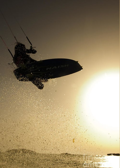 Kitesurfing Greeting Card featuring the photograph Kitesurfing At Sunset by Hagai Nativ
