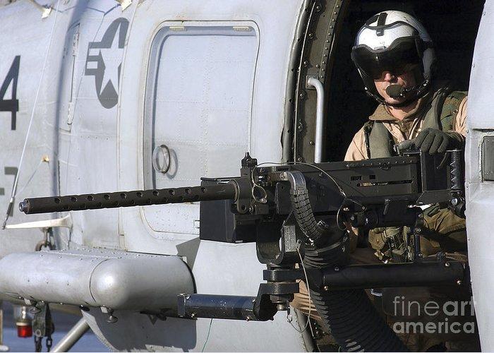 Door Gunner Greeting Card featuring the photograph Soldier Mans A .50 Caliber Machine Gun by Stocktrek Images