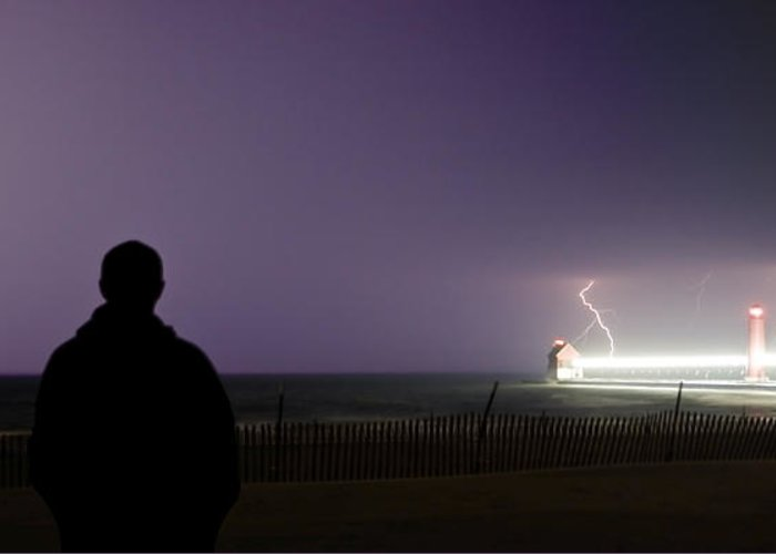 Lightning Greeting Card featuring the photograph Watching A Lightning Storm by Jeramie Curtice