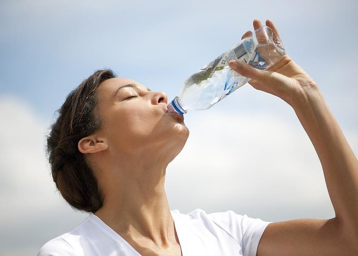 Healthcare Greeting Card featuring the photograph Woman Drinking Bottled Water by