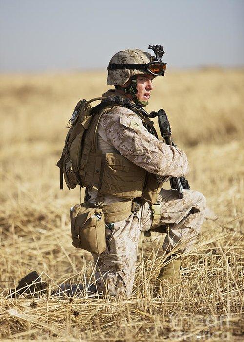 Ballistic Armor Greeting Card featuring the photograph U.s. Marine Patrols A Wadi Near Kunduz by Terry Moore