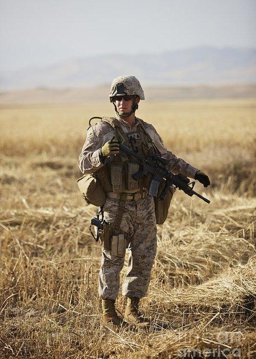 Field Greeting Card featuring the photograph U.s. Marine Patrols A Wadi Near Kunduz by Terry Moore