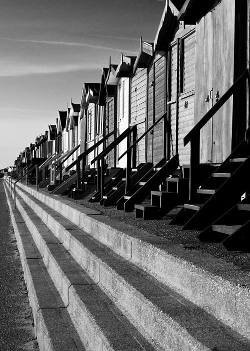 Frinton On Sea Greeting Card featuring the photograph Frinton On Sea Beach Huts by Darren Burroughs