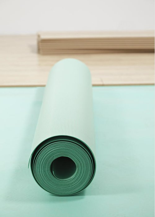 Nobody Greeting Card featuring the photograph Laying A Floor. Rolls Of Underlay Or by Magomed Magomedagaev