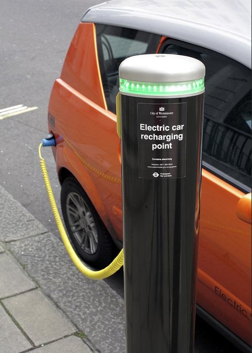 Mega City Greeting Card featuring the photograph Recharging An Electric Car by Martin Bond