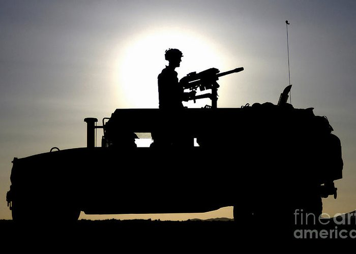 Horizontal Greeting Card featuring the photograph A Gunner Mans An Mk-19 40mm Machine Gun by Stocktrek Images
