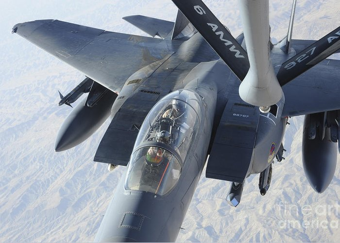 Kc-135 Stratotanker Greeting Card featuring the photograph A Kc-135 Stratotanker Refuels An F-15e by Stocktrek Images