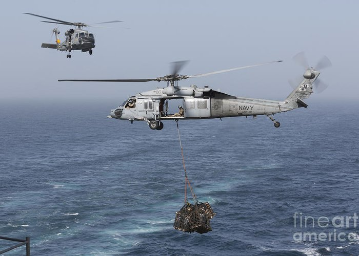 Arabian Sea Greeting Card featuring the photograph A Mh-60s Knighthawk Transfers Cargo by Gert Kromhout