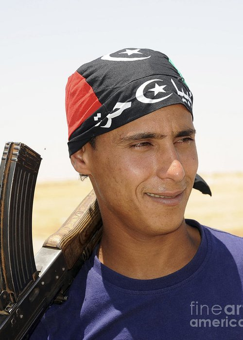 Benghazi Greeting Card featuring the photograph A Rebel Fighter With An Ak-47 Assault by Andrew Chittock