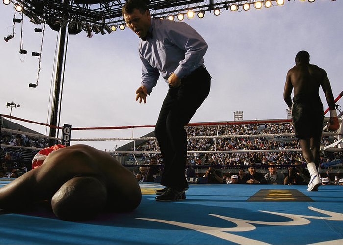 North America Greeting Card featuring the photograph A Referee Counts Out A Fallen Boxer by Maria Stenzel