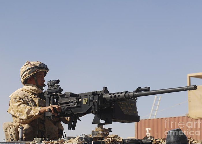 Middle East Greeting Card featuring the photograph A Royal Marine Manning A .50 Caliber by Andrew Chittock