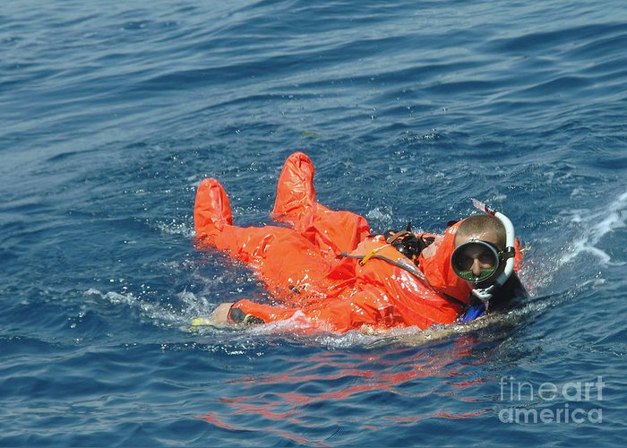 Color Image Greeting Card featuring the photograph A Sailor Rescued By A Diver by Stocktrek Images