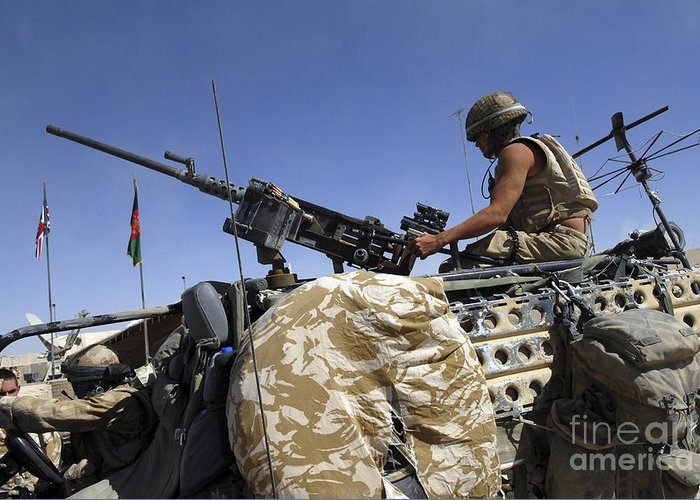 M2 Machine Gun Greeting Card featuring the photograph A Soldier Of The British Army Mans by Andrew Chittock