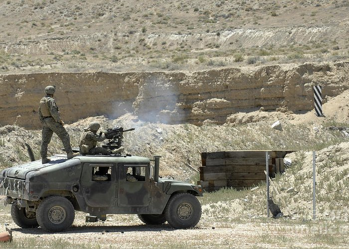 Vehicles Greeting Card featuring the photograph A U.s. Marine Fires A Mark 19-3 40mm by Stocktrek Images