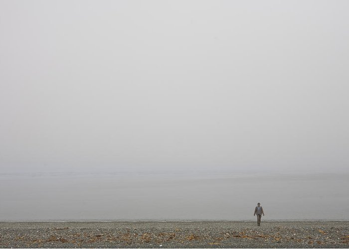 Queen Charlotte Islands Greeting Card featuring the photograph A Woman Walks Along The Beach by Taylor S. Kennedy