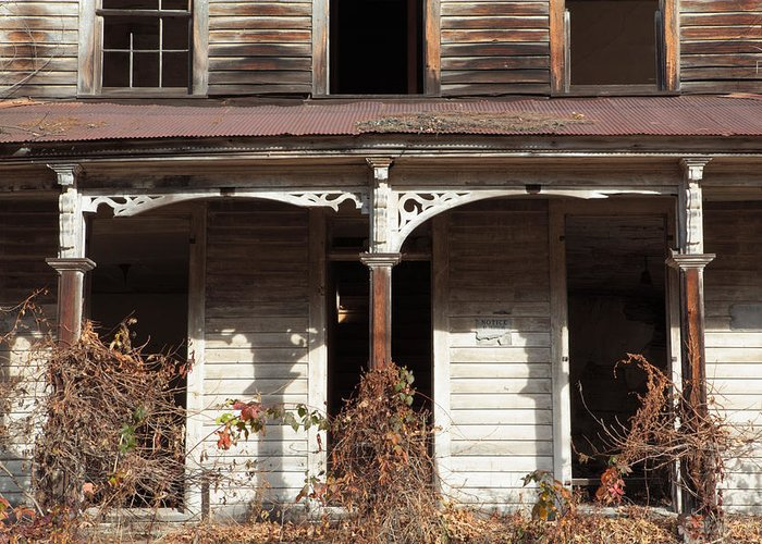 Architecture Greeting Card featuring the photograph Abandoned House Facade Rusty Porch Roof by John Stephens