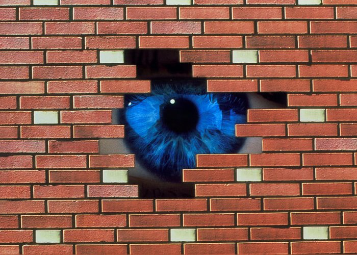 Agoraphobia Greeting Card featuring the photograph Abstract Of Eye Looking Through Hole In Brick Wall by Mehau Kulyk
