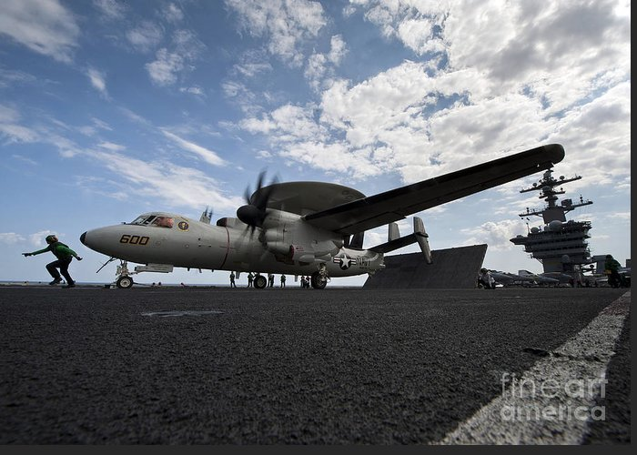 Motioning Greeting Card featuring the photograph An E-2c Hawkeye Aircraft Prepares by Stocktrek Images