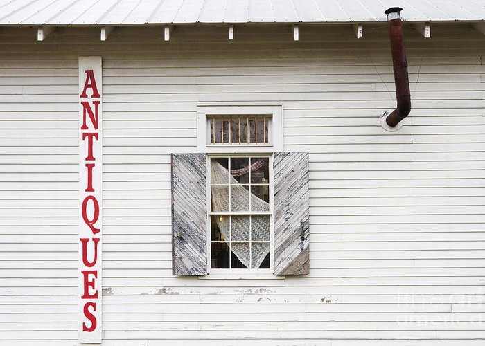 Advertisement Greeting Card featuring the photograph Antique Store Facade by Jeremy Woodhouse