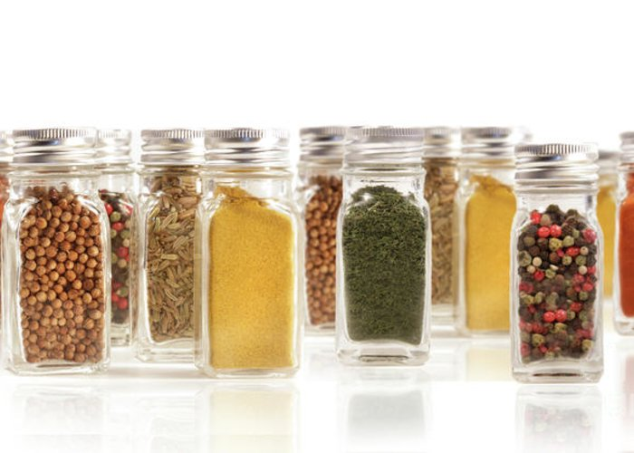 Allspice Greeting Card featuring the photograph Assorted Spice Bottles Isolated On White by Sandra Cunningham