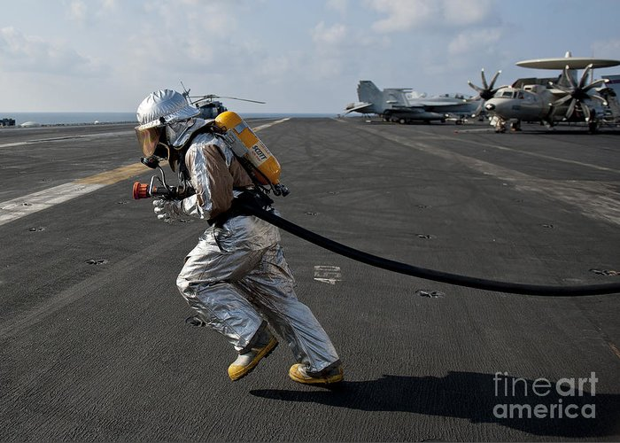 Operation Enduring Freedom Greeting Card featuring the photograph Aviation Boatswain's Mate Carries by Stocktrek Images