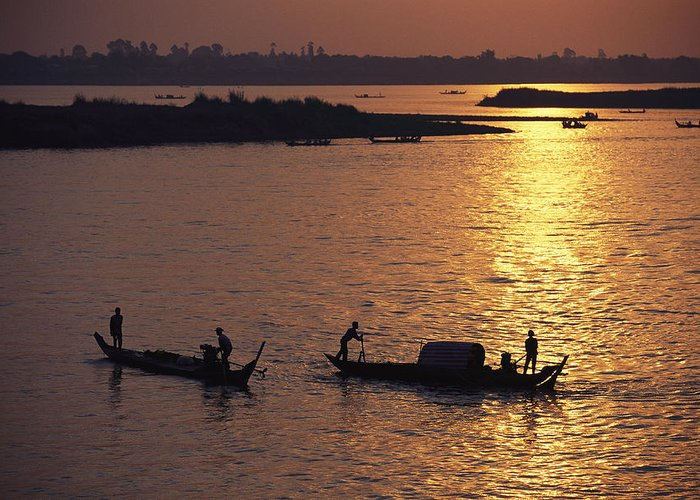 Asia Greeting Card featuring the photograph Boats Silhouetted On The Mekong River by Steve Raymer