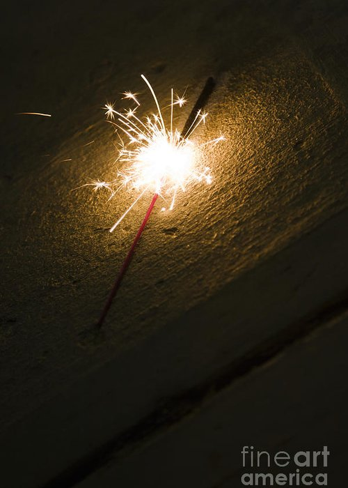 At Night Greeting Card featuring the photograph Burning Sparkler On Sidewalk At Night by Roberto Westbrook