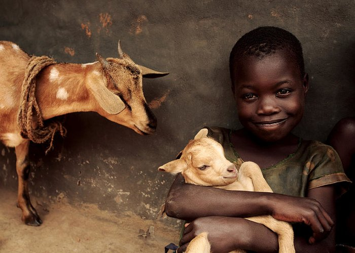 Livestock Greeting Card featuring the photograph Child Holding A Kid by Mauro Fermariello