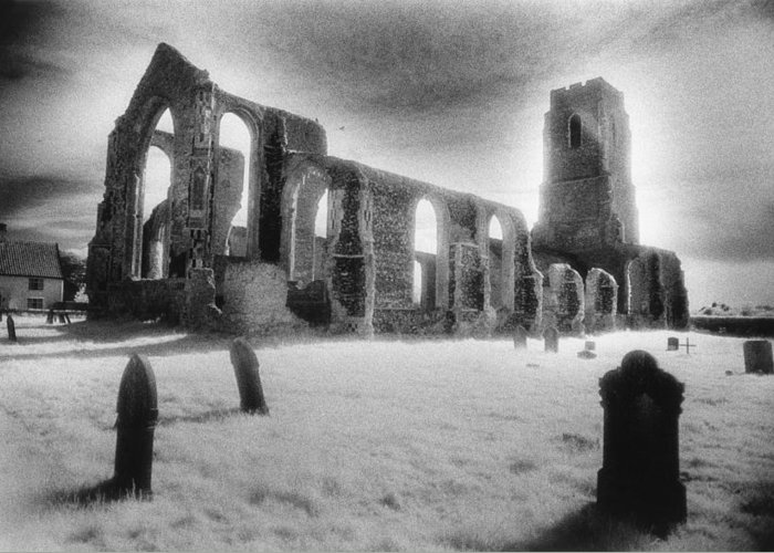 Bell Tower; Ruined; Ruin; Remains; Churchyard; Cemetery; Graveyard; Tombstones; Gravestones; Eerie; Atmospheric; Sinister; Ghostly; Dramatic; Striking; Mysterious; Gothic; Medieval; Architecture; English; Exterior; Landscape Greeting Card featuring the photograph Church Of St Andrew by Simon Marsden