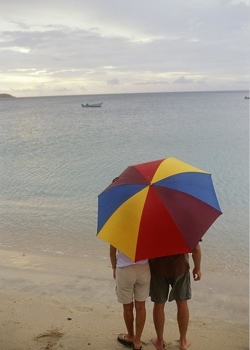 Atlantic Islands Greeting Card featuring the photograph Couple Holding Umbrella On Beach by Barry Tessman